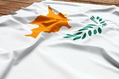 Flag of Cyprus on a wooden desk background. Silk Cypriot flag top view.  stock photography