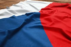 Flag of Czech Republic on a wooden desk background. Silk Czech flag top view.  royalty free stock photo