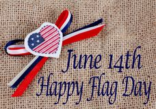 Flag Day USA. Vertical image of a blackboard with a number one teacher message. There is a green ruler and a red apple and white chalk are sitting on a stack of stock photo