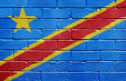 Flag of the Democratic Republic of the Congo. Painted onto a grunge brick wall Stock Image