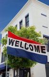 flag den huvudsmå gatatownvälkomnandet Arkivfoton