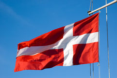 Flag of Denmark. Waving in a wind on boat mast, Nyhavn, Copenhagen Stock Photography