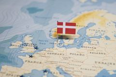The Flag of denmark in the world map stock photos