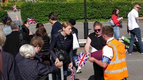 Flag distribution for royal wedding marriage Prince Harry and Me. Windsor, Berkshire, United Kingdom - May 19, 2018: Free flags distribution for royal wedding stock video