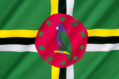 Flag of Dominica. Adopted on 3rd November 1978, with some small changes having been made in 1981, 1988, and 1990. Features the national bird, the Sisserou Royalty Free Stock Photo