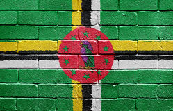 Flag of Dominica on brick wall Royalty Free Stock Images