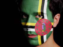 Flag of Dominica. Painted on a Face of a Young Man stock images