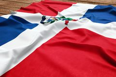 Flag of Dominican Republic on a wooden desk background. Silk Dominican flag top view.  stock images