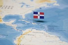 The Flag of dominican republic in the world map royalty free stock image