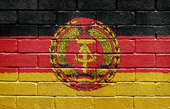 Flag of East Germany on brick wall Stock Photo