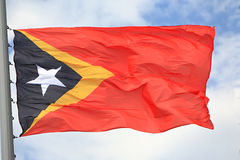 Flag of East Timor. Against the sky Royalty Free Stock Images