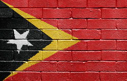 Flag of East Timor on brick wall Royalty Free Stock Images