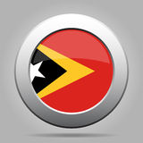 Flag of East Timor. Shiny metal gray round button. Stock Photography