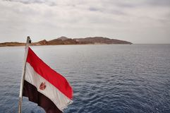 Flag of Egypt against the backdrop of the island of Tiran Stock Images
