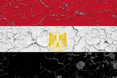 Flag of Egypt painted on cracked dirty wall. National pattern on vintage style surface royalty free stock images