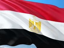 Flag of Egypt waving in the wind against deep blue sky. High quality fabric royalty free stock photo