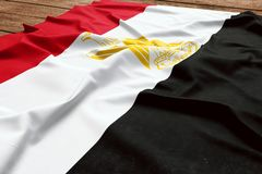 Flag of Egypt on a wooden desk background. Silk Egyptian flag top view.  royalty free stock photography