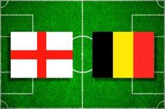 Flag England - Belgium on the football field. Football match.  Royalty Free Stock Photos