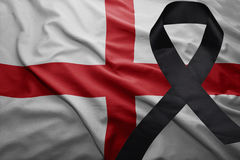 Flag of england with black mourning ribbon Stock Photography
