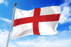 Flag of England developing against a clear blue sky. On a sunny day Royalty Free Stock Photo