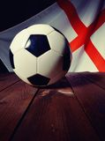 Flag of England with football on wooden boards. Royalty Free Stock Photography