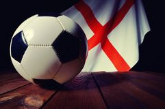 Flag of England with football on wooden boards. Stock Photos