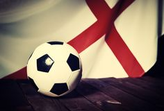 Flag of England with football on wooden boards. Royalty Free Stock Photos