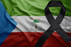 Flag of equatorial guinea with black mourning ribbon Stock Photo