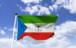 Flag of Equatorial Guinea, tree of silk cotton. Flag of Equatorial Guinea, green represents vegetation, blue the sea, white peace and red independence. The tree stock photography