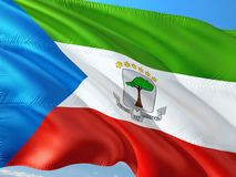 Flag of Equatorial Guinea waving in the wind against deep blue sky. High quality fabric.  stock image