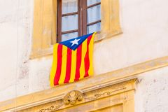 The flag Estelada on the facade of the building. Before the referendum on independence, Tarragona, Catalonia, Spain. Close-up. The flag Estelada on the facade Royalty Free Stock Images
