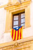 The flag Estelada on the facade of the building. Before the referendum on independence, Tarragona, Catalonia, Spain. Close-up. Ver. Tical Royalty Free Stock Photo