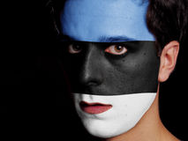 Flag of Estonia. Painted on a Face of a Young Man Stock Image
