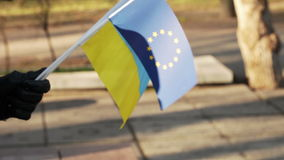 Flag EU and Ukraine. Demonstrator in the flag of the European Union and Ukraine stock footage