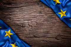 Flag of Europe union on old wooden background. EU flag old oak background.Vertical.  Royalty Free Stock Image
