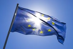 The flag of europe in the wind stock image