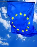 Flag of European Union. Photo of flag of European Union with sky on background Royalty Free Stock Image