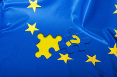Flag of European Union. Euroscepticism - Detail of Silky Flag of Blue European Union EU Flag Drapery With Puzzle Piece With Question Mark Stock Photography