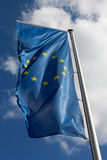 The flag of the European Union against a blue sky Stock Photography