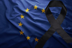 Flag of european union with black mourning ribbon. Waving national flag of european union with black mourning ribbon stock photo
