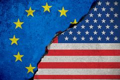 Flag of the european union on broken brick wall and half usa uni Stock Image