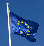 Flag of European Union fluttering in the wind. Against a clear blue sky, concept of freedom and unity Royalty Free Stock Photography
