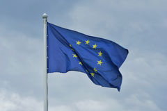 The flag of the European Union flutters on wind. Stock Image