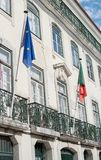 Flag of the European Union and Portugal. Flag of the European Union and Portugal on the facade of the building Stock Photo