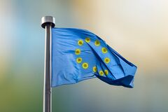 Flag of European Union with rond from bacteria of Coronavirus.