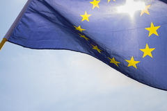 Flag of European Union. Sun shining throuhg, sky in the background Stock Images