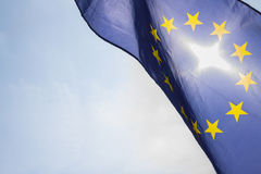 Flag of European Union. Sun shining throuhg, sky in the background Royalty Free Stock Photography