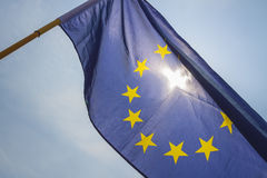 Flag of European Union. Sun shining throuhg, sky in the background Stock Photos