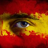 Flag on face. Flag painted on face of a national team supporter, close up of a male eye Royalty Free Stock Images
