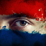 Flag on face. Flag painted on face of a national team supporter, close up of a male eye Royalty Free Stock Photos